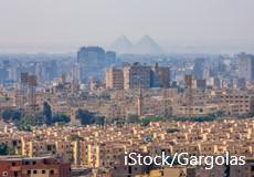 Cairo with the pyramids in the background. Copyright IStock/Gargolas